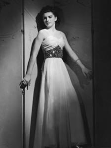 woman-in-an-evening-dress-circa-1940-s