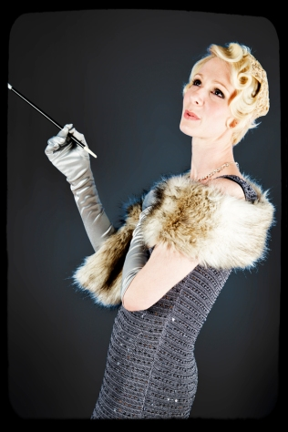 1920s hair and make up, and an elegant pose with a long cigarette