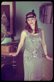 Girl in 1920s dress with gramophone