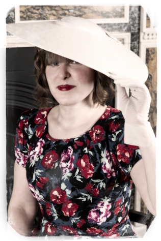 1950s vintage vogue pose with hat