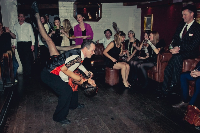 1920s Charleston dancers performing at a Speakeasy Christmas party